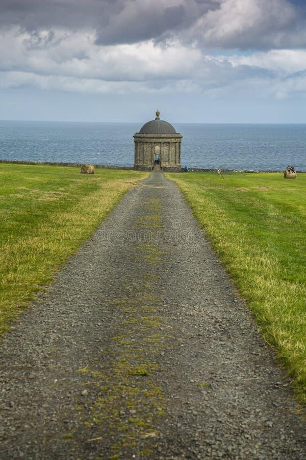 Mussenden Temple north ireland. Northern Ireland - Aug 01, 2017: Mussenden Temple a popular tourist attraction on the Atlantic Ocean coast of Northern Ireland stock image