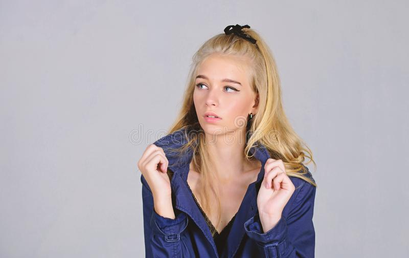 Must have concept. Woman makeup face blonde hair posing coat with collar. Fashionable coat. Clothes and accessory. Girl. Fashion model wear coat for spring and stock photos
