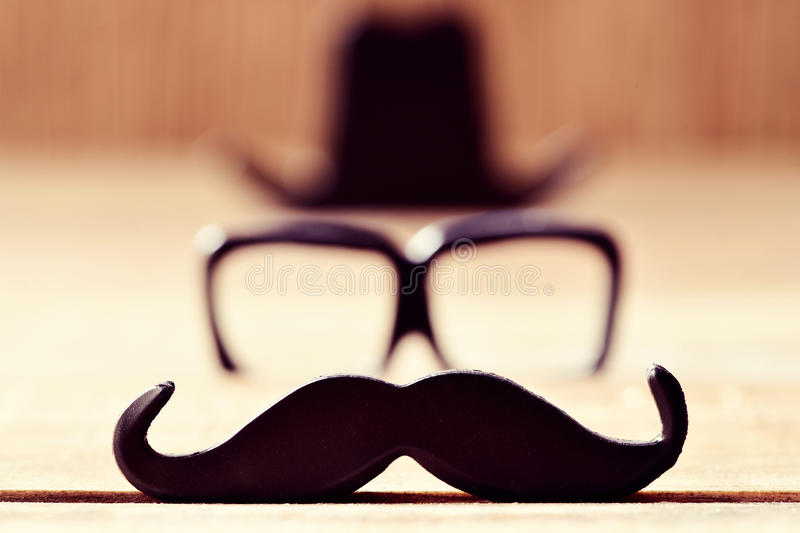 Mustache, eyeglasses and hat forming the face of a man stock photo