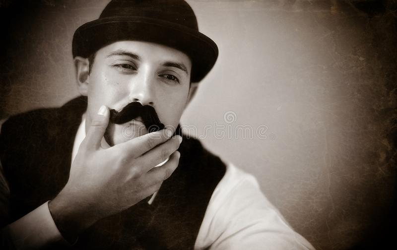 Mustache man. A man with a mustache and a bowler hat stock photo