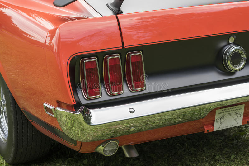 Mustang rear end. Picture of vintage mustang rear end, 1969 mustang boss 302 with black rear end stock photography
