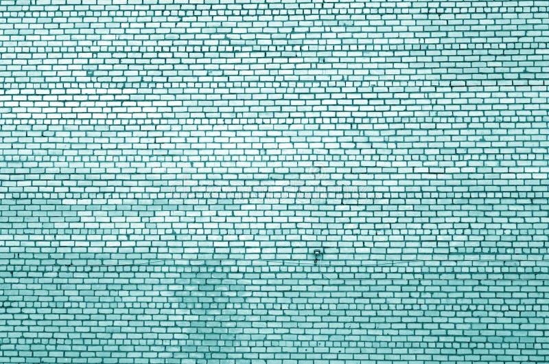 Muster der Backsteinmauer mit Unsch?rfeeffekt im cyan-blauen Ton stockbilder