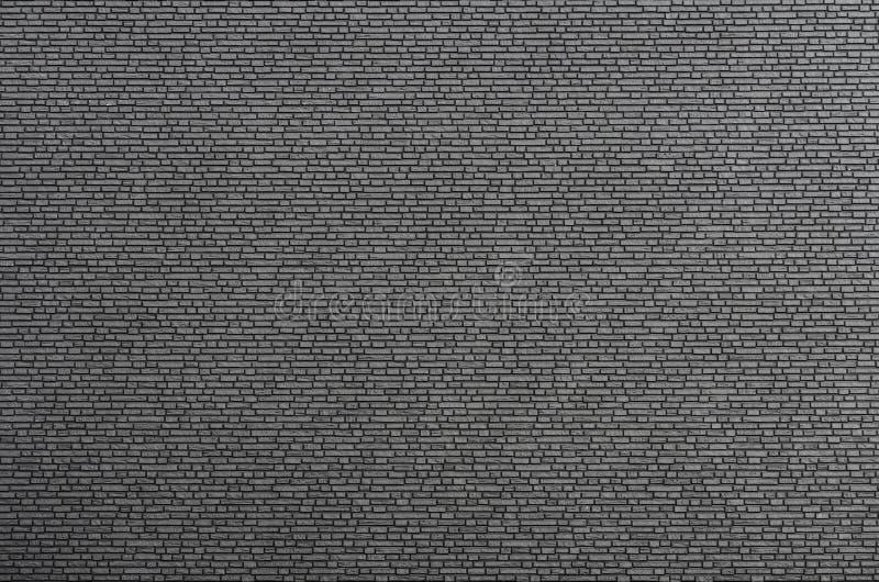 Muster der dunklen kleinen Backsteinmauer stockfotos