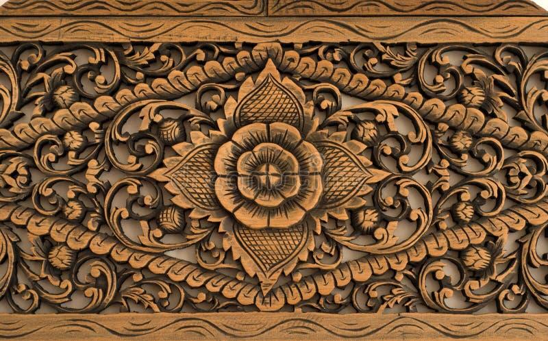 Muster der Rose geschnitzt auf Holz lizenzfreie stockfotos