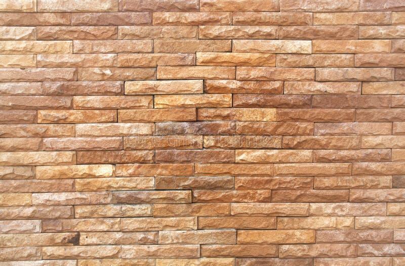 Muster des dekorativen Steinwandhintergrundes stockfoto
