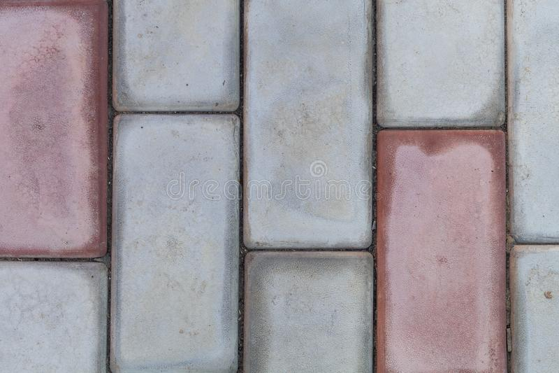 Muster des Ziegelsteinblockes auf Gehweg, Dreieckblock ist Unterschied stockbild