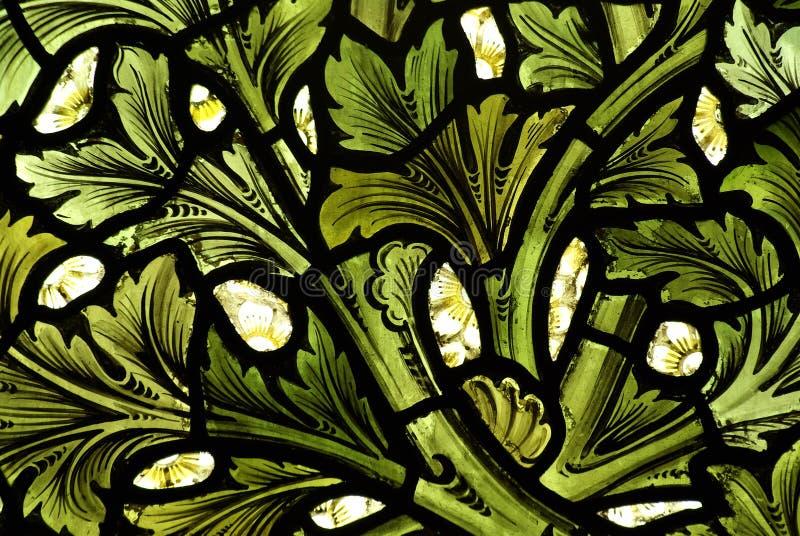 Muster von Blättern im Buntglas stockbilder