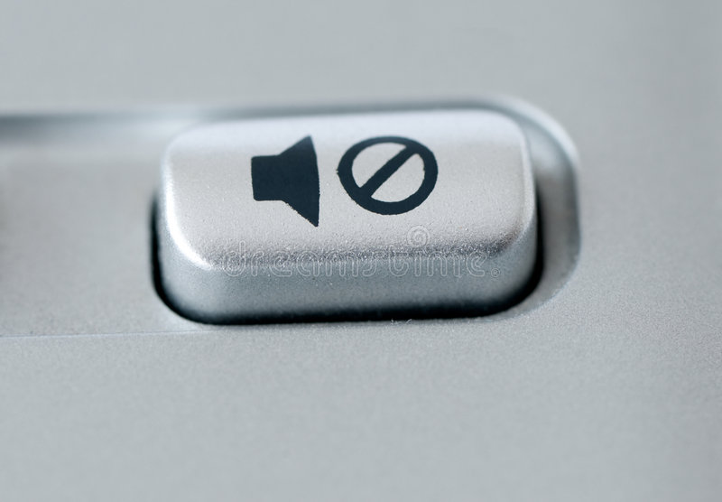 Mute button. Macro image from a keyboard stock image