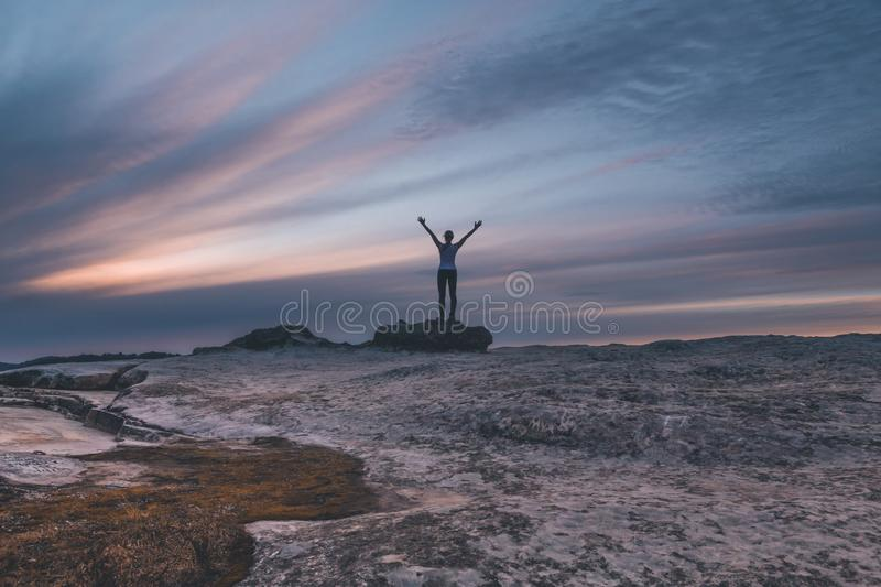 Female arms outstretched to the sky at Lincolns Rock Blue Mountains royalty free stock photography
