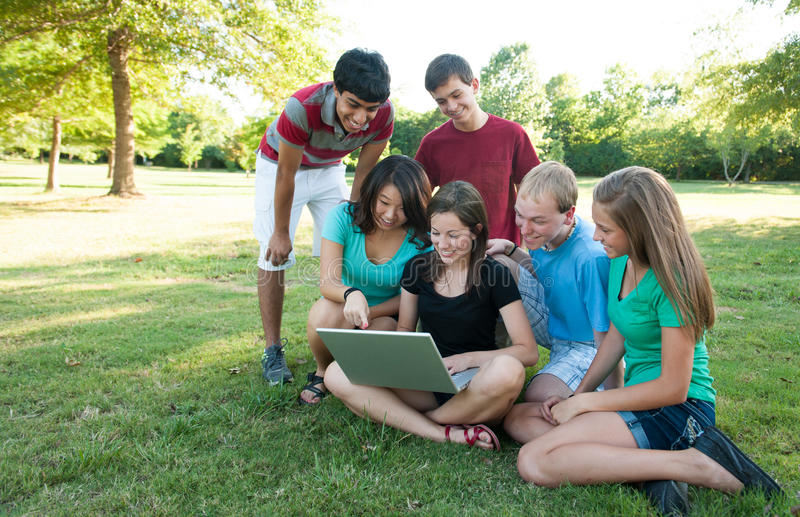 Muti-ethnic group of teens outside royalty free stock photo