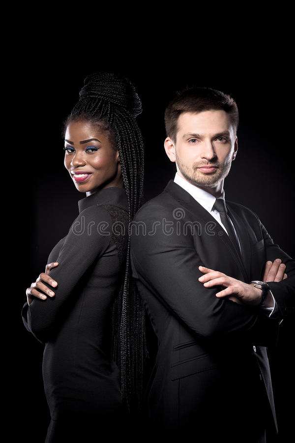 Mutri ethnic man and woman standing back to back. royalty free stock photo