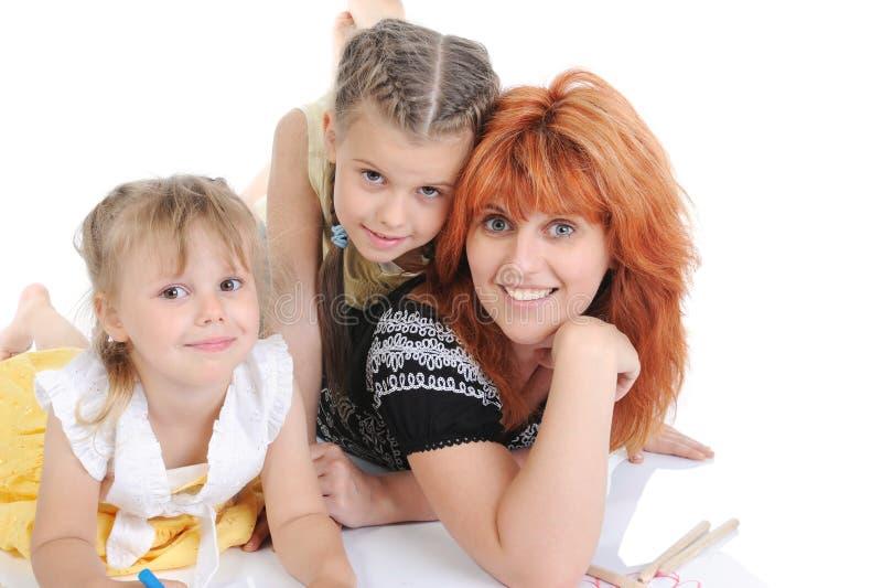 Mutter mit ihren Töchtern. lizenzfreie stockfotos