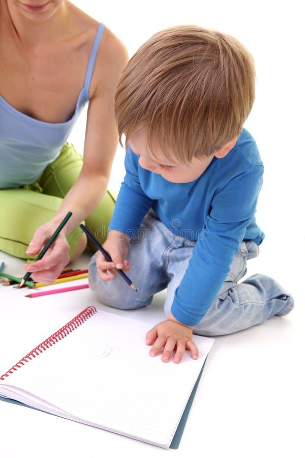 Mutter- und Sohnzeichnung stockfoto