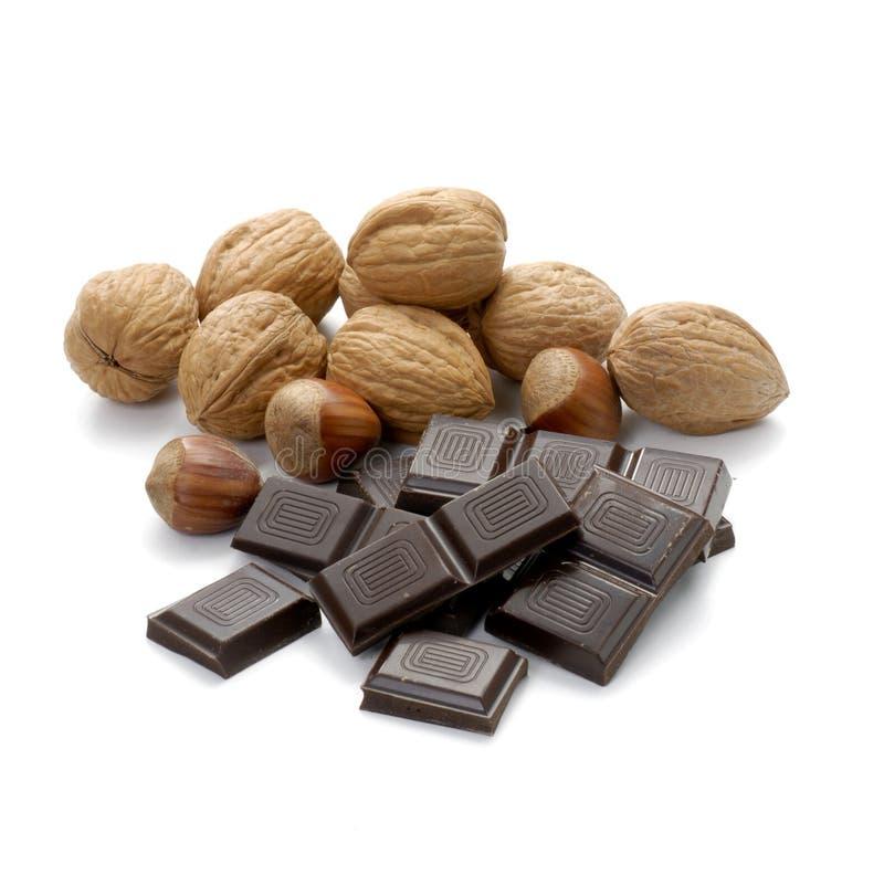 Muttern und Schokolade stockfotografie