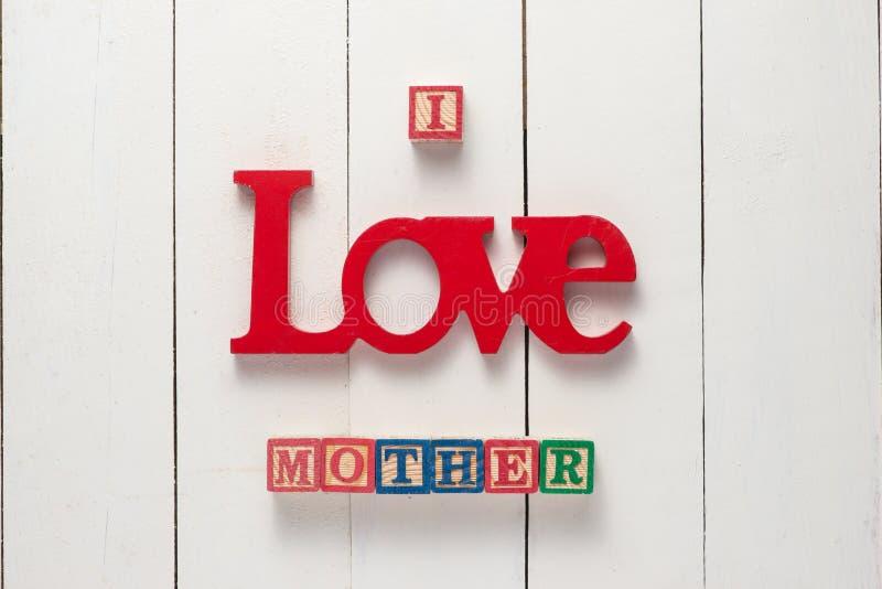 Muttertag-Konzept - i-LIEBES-MUTTER stockbilder