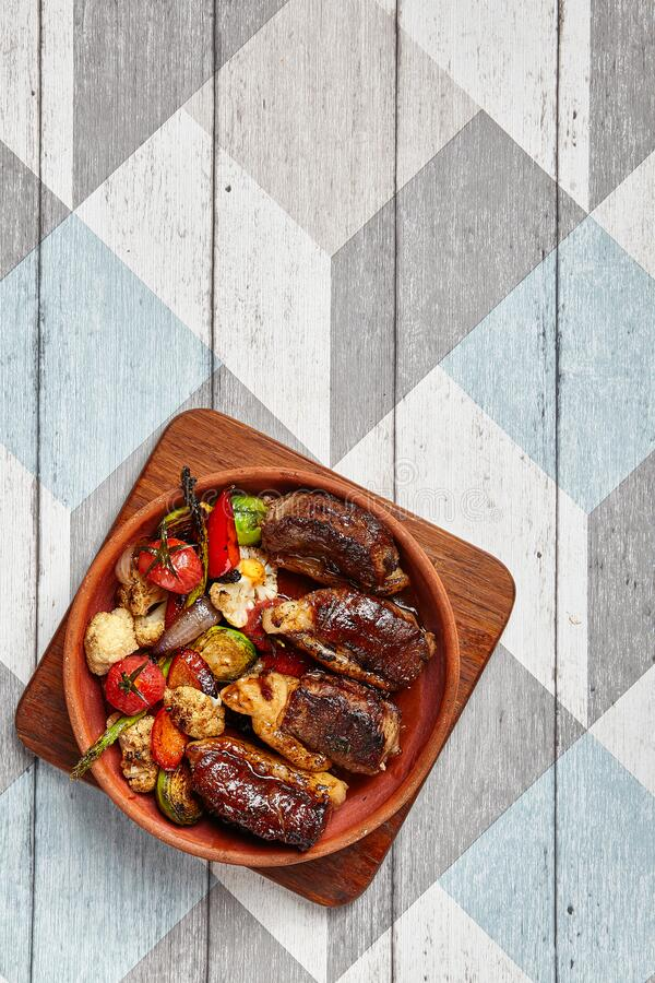 Mutton baked with vegetables stock photos