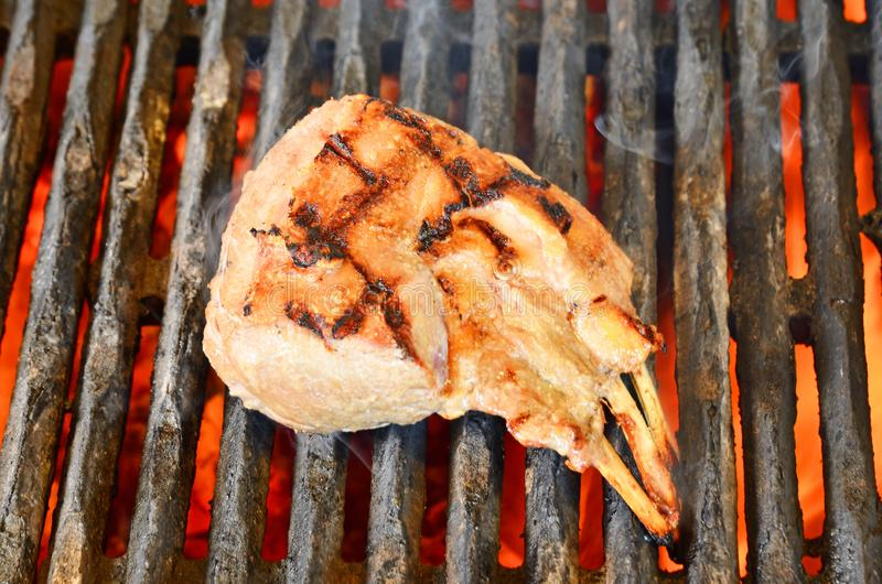 Mutton Chops BBQ. Mutton chops on a grill royalty free stock images