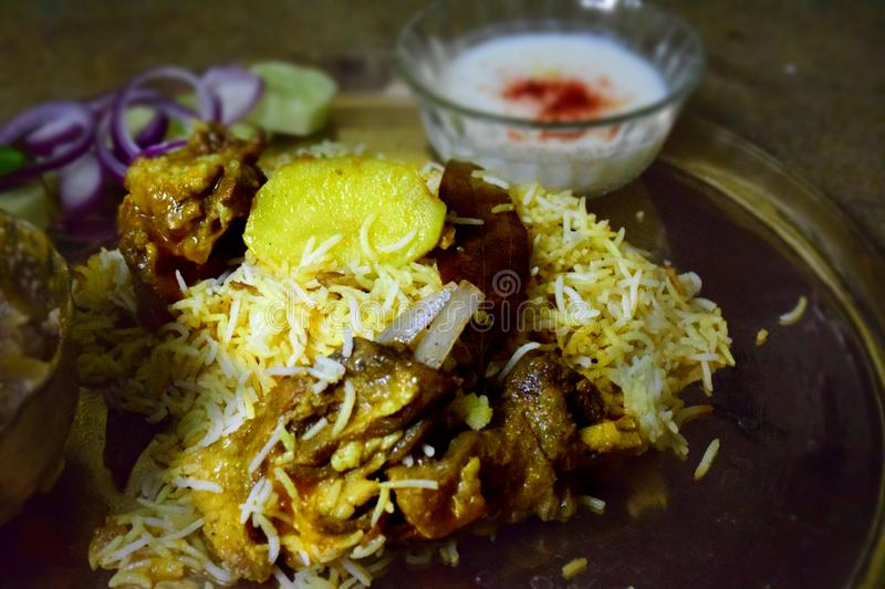 Mutton or lamb Biryani is most well-known delights from the famous Mughlai  Cuisine. It is a traditional dish made using Basmati rice, meat, saffron, various royalty free stock photo