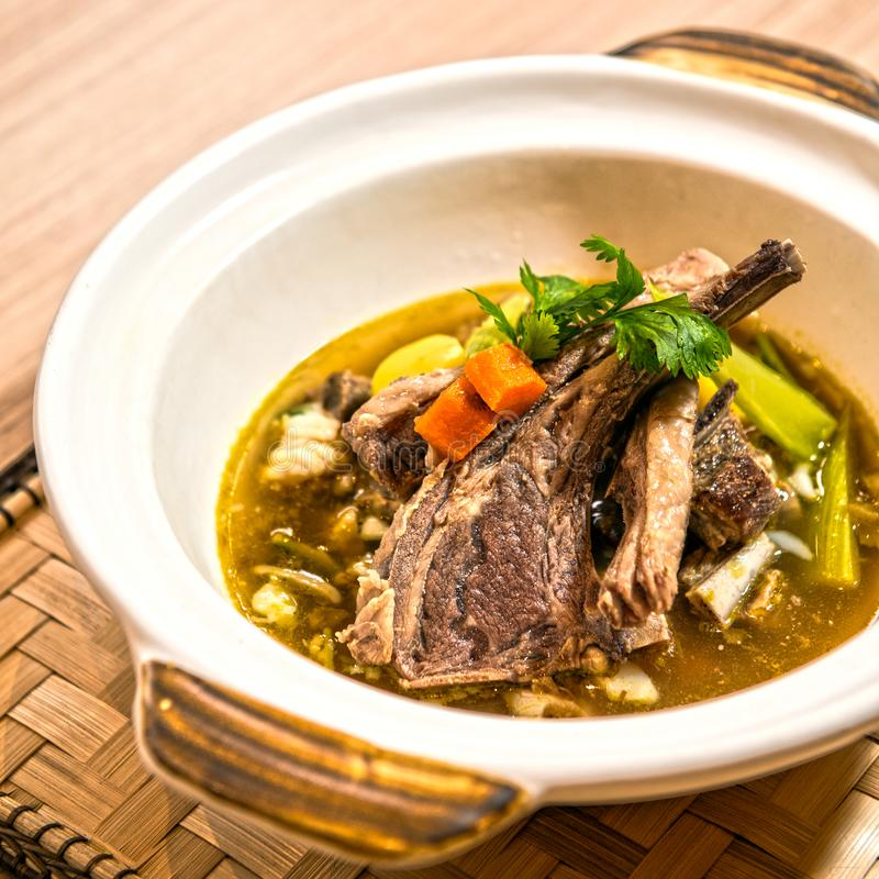 Mutton Soup. Sup Kambing or mutton soup is commonly found in Malaysian and Indonesian cuisine. It is prepared with goat meat, tomato, cerely, spring onion royalty free stock image