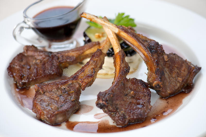 Mutton steak. On white plate royalty free stock image