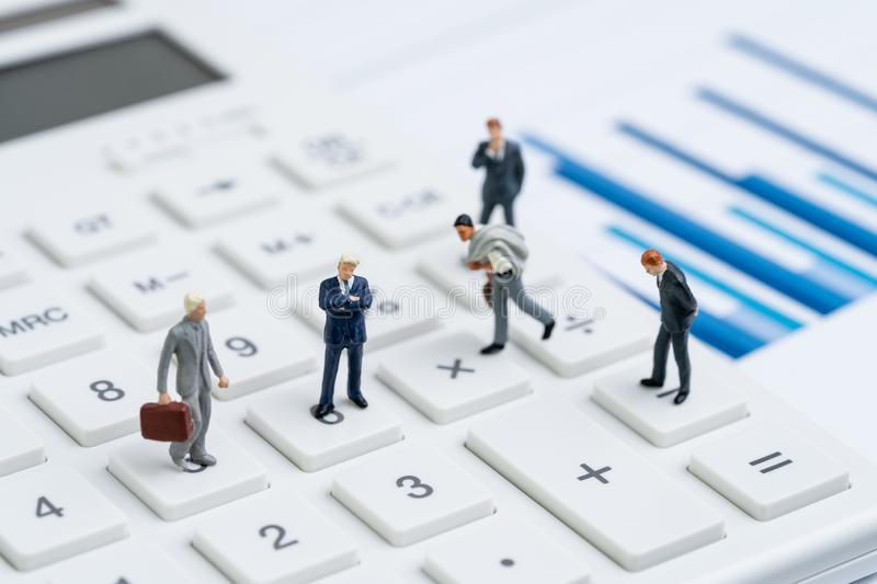 Mutual funds, business performance success, profit and loss in accounting or company management concept, miniature people figurine. Businessmen standing on stock image