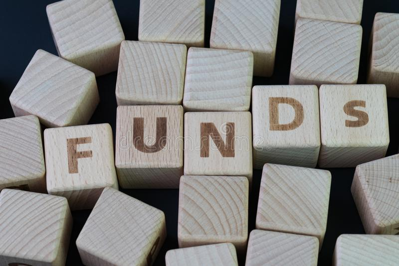Mutual funds, investment asset selection by performance concept, cube wooden block with alphabet combine the word abbreviation royalty free stock image