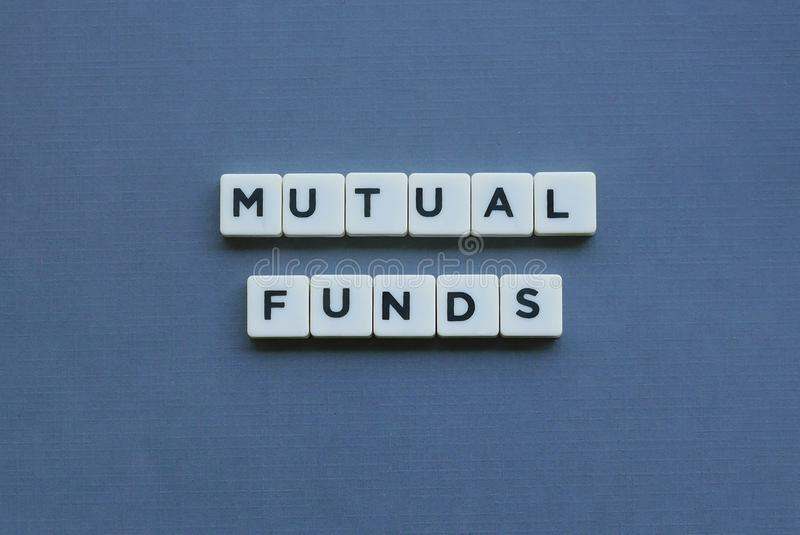 ' Mutual Funds ' word made of square letter word on grey background. Money, financial, investment, wealth, retirement, finance, income, profit, bond royalty free stock photos