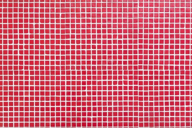 Muur met kleine rode tegels stock foto