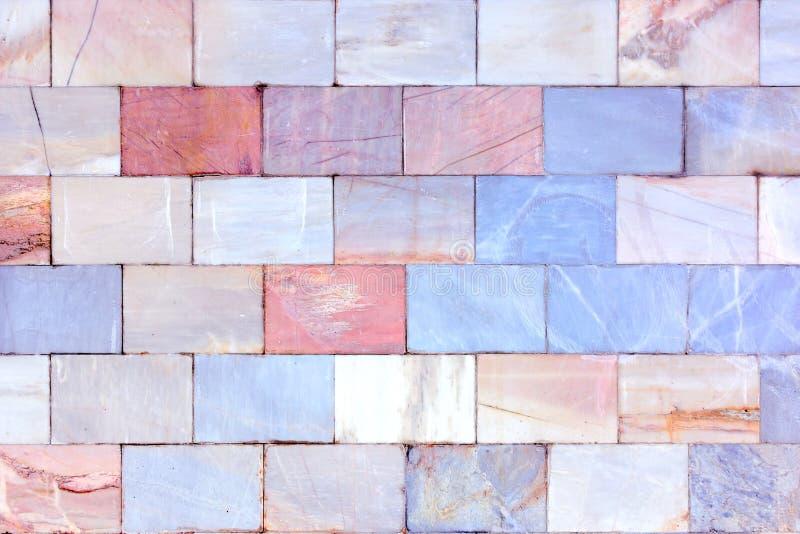 Muur van marmer Ongebruikelijke steentextuur Achtergrond van tegels royalty-vrije stock foto's