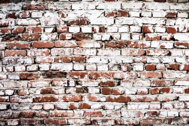 Muur van oude baksteen met een witte aanrakings abstracte achtergrond stock fotografie