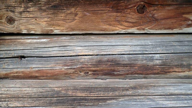 Muur van oude bruine logboeken stock afbeelding