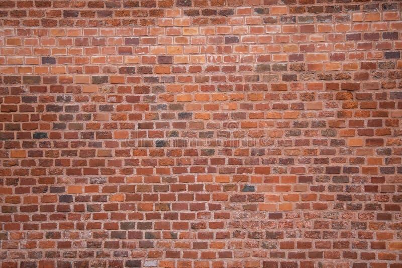 Muur van oude rode baksteen stock foto