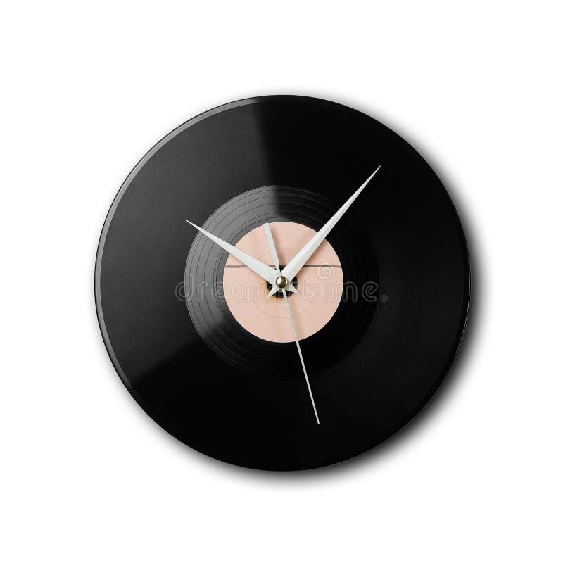 Muurklok in de vorm van oude zwarte grammofoonplaten Sluit omhoog Ge?soleerdj op witte achtergrond royalty-vrije stock foto