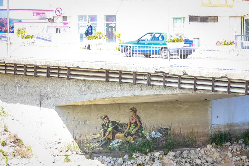 Muurschildering onder brug stock afbeelding