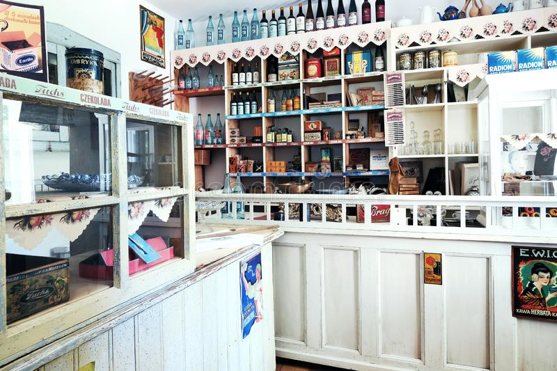 Interior of old eastern european convenience store with shelves full of vintage cans, boxes, bottles and other containers with royalty free stock photo