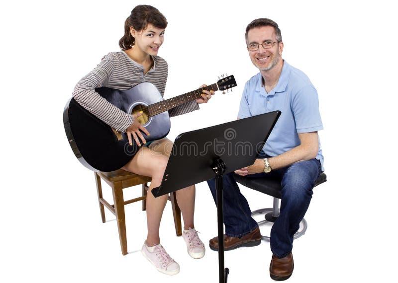 Muziekleraar en Student stock afbeelding