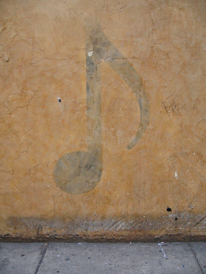 Muzieknoot op muur royalty-vrije stock foto's