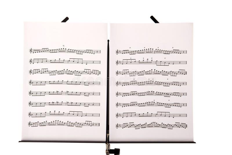 Muzyczny stojak z melodii prześcieradłami zdjęcie stock