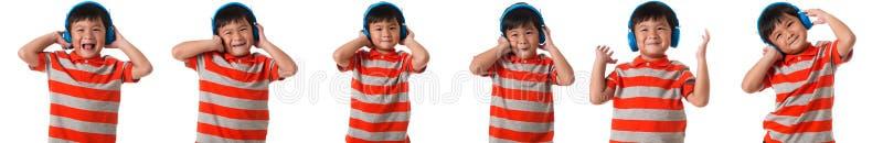 Muzyka i technologii pojęcie - set azjatykcia chłopiec z hełmofonami odizolowywającymi obrazy stock