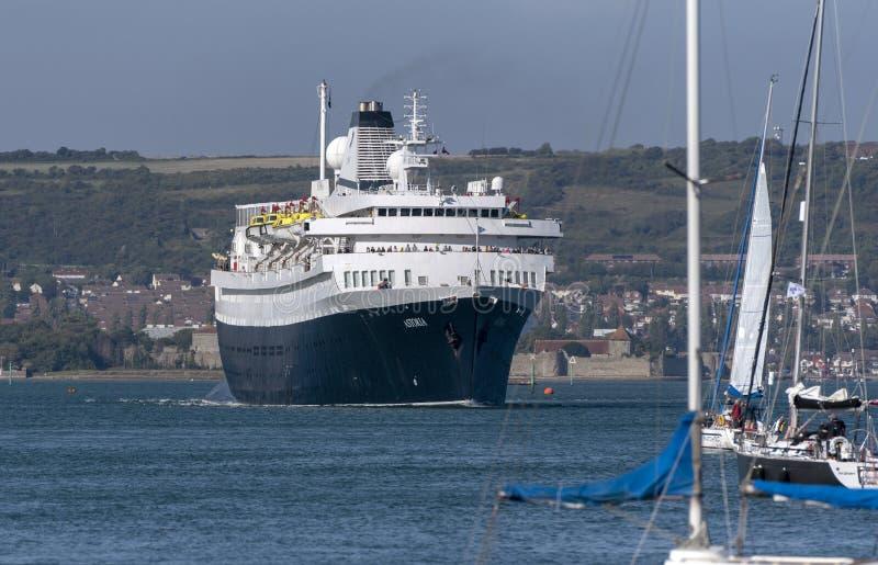 Old cruise ship MV Astoria sailing out of Portsmouth England UK royalty free stock photo