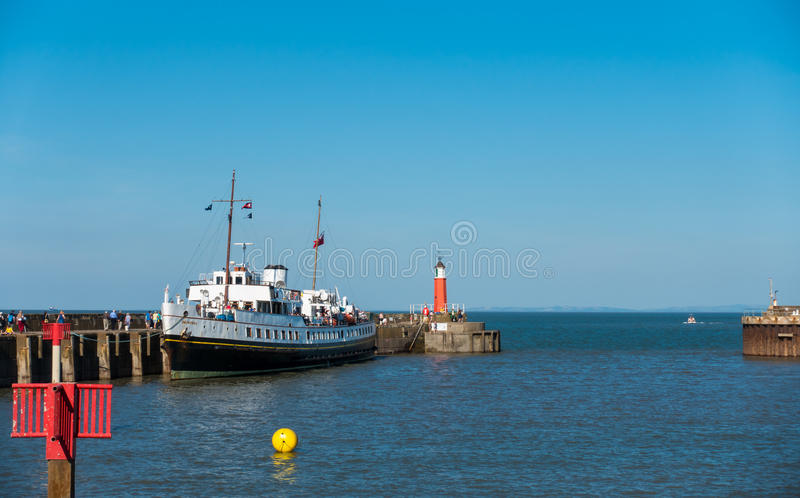 MV Balmoral ship with Passengers in Watchet Harbour. Watchet, United Kingdom - August 15, 2016: Passengers are walking to board the MV Balmoral ship to continue stock image