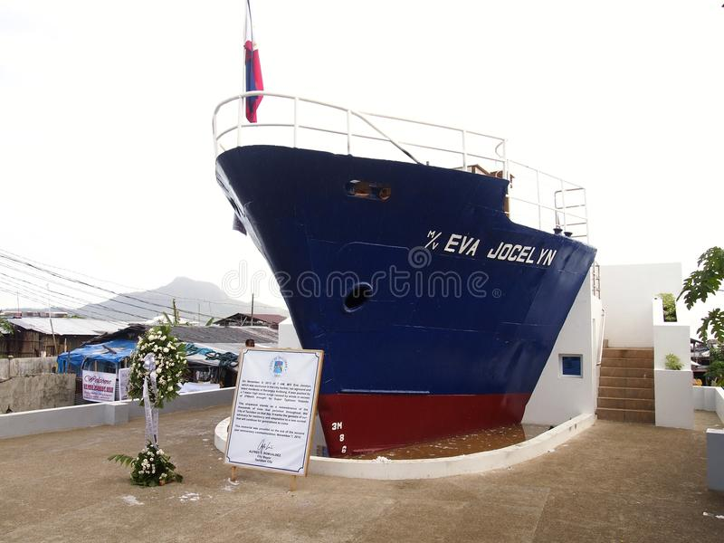 MV EVA Jocelyn's shipwreck. TACLOBAN CITY, PHILIPPINES - NOVEMBER 9, 2015: A part of MV EVA Jocelyn's shipwreck stands on the exact spot where back in November 8 stock image