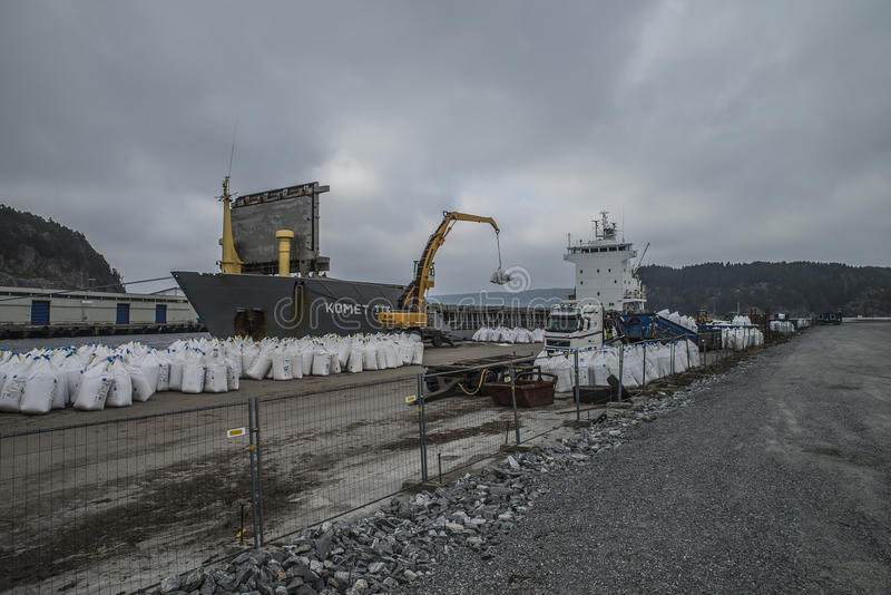 Mv Komet III unloads chemical goods. Photo shows mv Komet III which unloads chemical goods at the port of Halden, Norway. The goods will be transported on stock photos