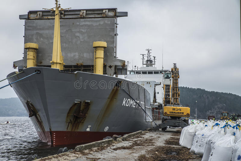 Mv Komet III unloads chemical goods. Photo shows mv Komet III which unloads chemical goods at the port of Halden, Norway. The goods will be transported on stock image