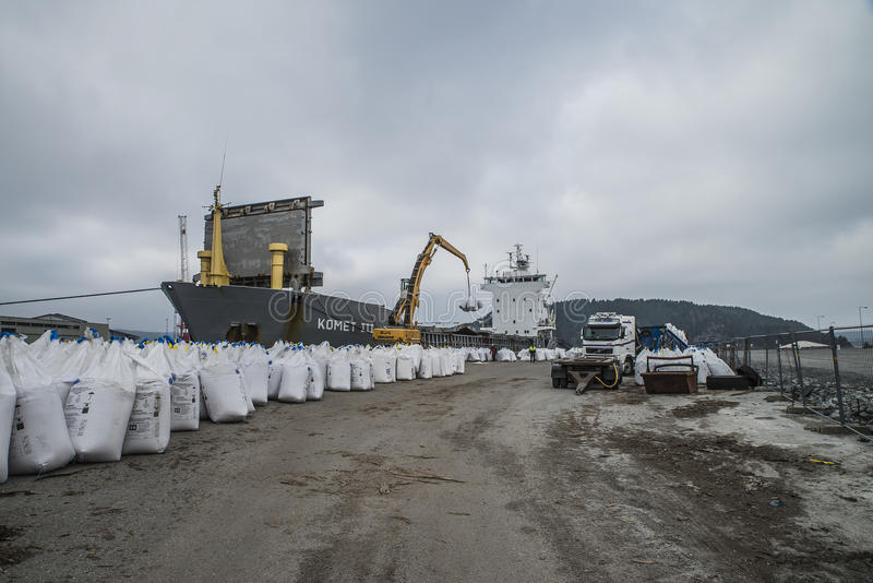 Mv Komet III unloads chemical goods. Photo shows mv Komet III which unloads chemical goods at the port of Halden, Norway. The goods will be transported on stock photography