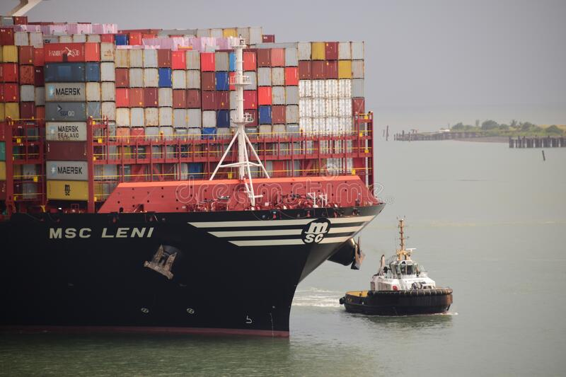 Mega container vessel arriving to the port royalty free stock photo