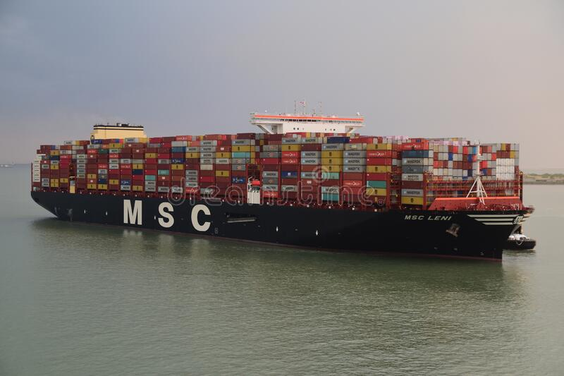 Mega container vessel arriving to the port stock photography