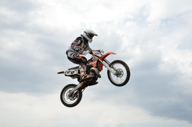 MX spectacular control of the motorcycle in flight. RUSSIA, SAMARA, TOLYATTI - MAY 6: MX rider E. Pershin spectacular control of the motorcycle in flight, the royalty free stock photography