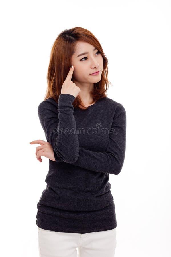 Myśląca młoda Azjatycka kobieta fotografia royalty free