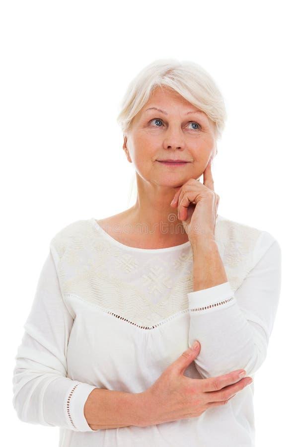 myślące starsza kobieta zdjęcie royalty free